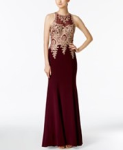 https://www.macys.com/shop/product/xscape-floral-lace-mermaid-gown?ID=3028158&CategoryID=5449&swatchColor=Wine%2FGold#fn=SPECIAL_OCCASIONS%3DFormal%26SIZE%3D%26sp%3D1%26spc%3D867%26ruleId%3D78%7CBOOST%20SAVED%20SET%7CBOOST%20ATTRIBUTE%26searchPass%3DmatchNone%26slotId%3D51